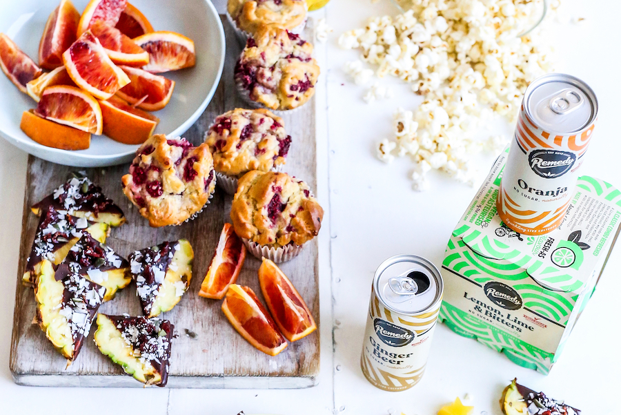 Remedy Ginger Beer, Lemon, Lime & Bitters and Oranja with party food including pineapple and popcorn