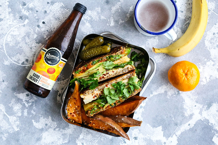 Remedy Good Energy Coffee with lunchbox with sandwich, pickles, sweet potato wedges, bananas and mandarin