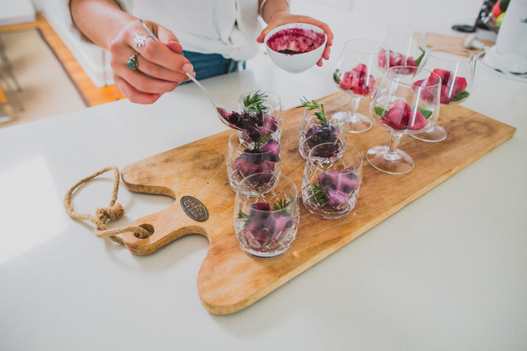 Thyme and Blueberry Kombucha Cocktail served on a wooden board